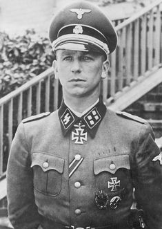 """SS-Sturmbannfuhrer Kurt Meyer (Summer 1941). Nicknamed """"Panzer Meyer"""" (1910-1961), he served as an officer in the Waffen-SS during the World War II. He saw action in the invasion of France, Operation Barbarossa, and the Battle of Normandy. After the war, he was put on trial for war crimes relating to the shooting of Allied prisoners in Normandy, for which he was sentenced to death. The sentence was commuted to life imprisonment. He petitioned for clemency and was released in 1954."""