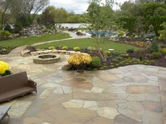 Armegast Residence including waterfall, stream, flagstone patios, firepit, pool, outdoor kitchen and then some