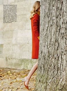 Major fall vibes with a blood-orange coat and clear heeled pumps // Photo by Julia Noni for Vogue Germany