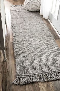 "Features: -Construction: Hand woven. -Material: 100% Jute/sisal. -Made in India. -Pile Height: 0.5"". -Product Weight: 10 - 64 lbs. Technique: -Hand woven. Primary Color: -Gray. Material: -Jute"
