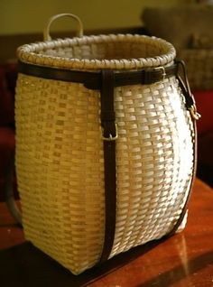 x x Woven, split-work construction; hand-split black ash and white oak, saddle leather straps Woven from New Hampshire black ash with white oak rim and handle, t… Red Basket, Bushcraft, Birch Bark, Saddle Leather, White Oak, Leather Working, Basket Weaving, New England, Rattan