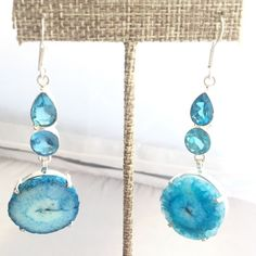 Sterling Silver Solar Quartz & Blue Topaz Earrings Stunning Blue Solar Quartz with real Blue Topaz stones set in Sterling Silver drop earrings.  Such a pretty blue and so stylish right now!   Only one pair, don't hesitate!   New, worn only for photos.  NO TRADES  Free Beauty Sample With Purchase  Code 14566-6. Jewelry Earrings
