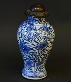An 18th Century Chinese Blue and White Jar, of mei ping form, with underglaze blue decoration, with wood top, the neck with hairline cracks, chipping to glaze near foot, appx. 4 1/2 in. H.