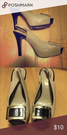 Nine West heels size 7 Nine West tan and black heels with gold buckle. Worn for one meeting so they are in like new condition. No signs of wear Nine West Shoes Heels