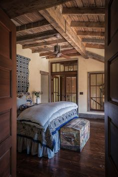I like the double doors with the transom-and the beam ceiling. This is my dream bdr.