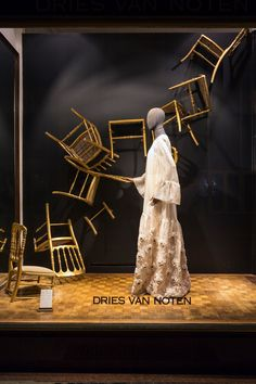 the dining room chairs are flying trough the room, pinned by Ton van der Veer