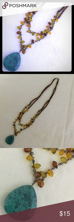Fabric, Bead, and Stone Necklace Unique and natural looking necklace. Dark brown, soft flat fabric on top, light and dark brown beads leading to a turquoise speckled pendant. Clasped at the back. Excellent condition Jewelry Necklaces
