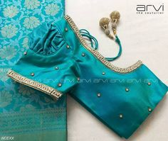 Embroidery for classy lovers. Simple and elegant with powder blue color designer blouse with hand embroidery work. New Saree Blouse Designs, Kids Blouse Designs, Simple Blouse Designs, Stylish Blouse Design, Bridal Blouse Designs, Hand Designs, Estilo India, Designer Blouse Patterns, Embroidered Blouse