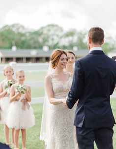 Darling Florida Wedding At A Family Farm Lush With Spanish Moss: All eyes are on this blushing bride in her stunning WToo Watters lace dress!