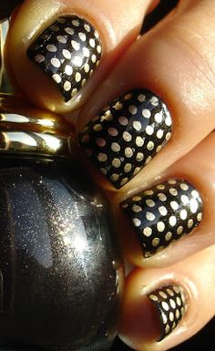 """Black and gold polka dot nails. Black nail polish is """"Diva"""" by Dior and the gold dots are """"Good As Gold"""" by Essie."""