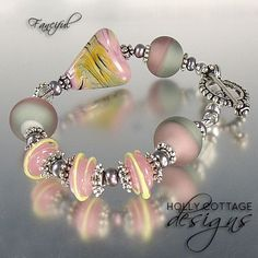 Artisan crafted lampwork bead bracelet in pink and grey found on Ruby Lane