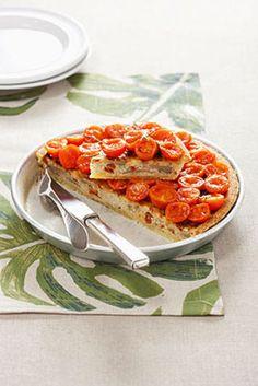 Torta di riso e tonno con pomodori Ecco una ricetta tipica della tradizione ligure. Una torta salata morbida, gustosa e sana