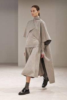 The Row Fall 2014 absolutely adore this scandi style lagenlook,asymmetrically layered shawl coat in oatmeal grey fab sophisticated chic design for those who love folk and arty fashion...must have it alice