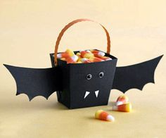 Kids will flip at this batty Halloween bucket! Trace and cut out the pattern using black cardstock, then fold the edges to make the bucket. Add black wings to either side of the bucket and secure with tape to create your winged creature! Glue on tiny googly eyes (bats have small eyes) and cut two white triangles using cardstock for fangs! Secure with glue below the bat eyes, and you're ready to go candy hunting with your new nighttime friend!