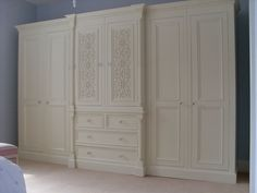 Ivory French White Painted 10ft Large 6 door Jali Style Solid Pine Wardrobe Quality handmade bespoke wardrobes from  designedinteriorsltd Large Wardrobes, Bespoke Wardrobes, Built In Wardrobe, Pine Wardrobe, Wardrobe Ideas, Painted Built Ins, Built In Robes, Shop Fittings, Solid Pine