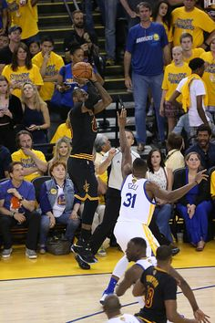 LeBron James of the Cleveland Cavaliers shoots against the Golden State Warriors during Game Seven of the 2016 NBA Finals on June 19 2016 at ORALCE...