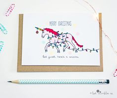 Because unicorns. Includes a recycled brown envelope for mailing.  The perfect Christmas card for unicorn believers!  **Need more than one?**  Mix and match 5 cards for £10 here: http://etsy.me/1d3LsV4 Mix and match 10 cards for £18 here: http://etsy.me/1f1RVBP Mix and match 15 cards for £25 here: http://etsy.me/1d3LzzS  **Details**  ∙ Unique hand-drawn design by Lost Marbles Co, digitally finished ∙ Blank inside for your own impressive personal greeting ∙ Quality 300gsm white card ∙ A6 when…