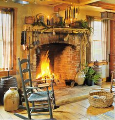 Prim...old fireplace  crocks...love this whole room.