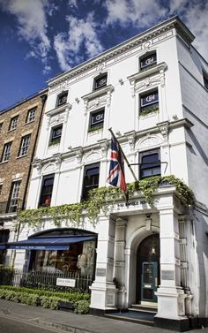 How etiquette coaches teach China's power men the finer points of fashion (Exterior of the shop of Gieves & Hawkes at No. 1 Savile Row, London, one of the destinations on the Debrett's course.)