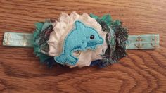 Check out this item in my Etsy shop https://www.etsy.com/listing/247799566/dolphin-two-tiered-shabby-headband
