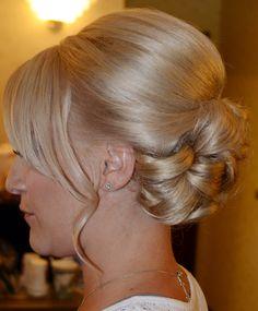 Wedding updo with side bangs
