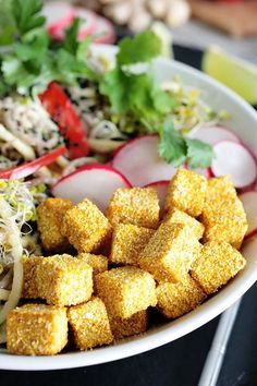 Delicious soba noodle bowl with cornmeal breaded tofu, crunchy veggies and a creamy and spicy almond dressing. Vegan + gluten-free