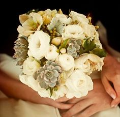 love the neutral colored flowers mixed with succulents