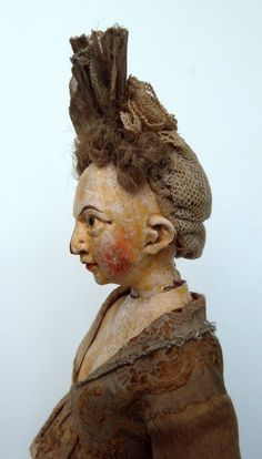 A very rare very early German wooden doll. Note her very unusual neck pinning…