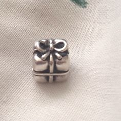 Authentic Pandora Present Charm (Retired) In great condition!  ⛔️ NO TRADES, NO PAYPAL, NO MERCARI, NO HOLDS ⛔️ smoke free, pet free home  let me know if you have other questions  PLEASE MAKE OFFERS THROUGH THE OFFER BUTTON. Pandora Jewelry