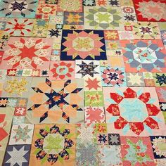 """Big Swoon blocks, mini Swoon blocks, Swoon Sixteen blocks and a whole lot of 8"""" and 4"""" stars to go with them."""