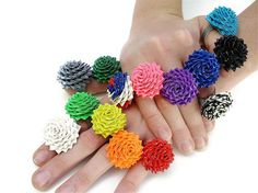 Here's a new picture of our duct tape rings, with as many rings as we we had on hand! so many we had get creative. All the Duct Tape Rings Duct Tape Projects, Duck Tape Crafts, Craft Projects, Craft Ideas, Decorating Ideas, Duct Tape Rose, Duct Tape Flowers, Fabric Flowers, Fun Crafts
