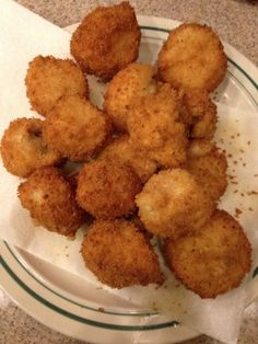 "Fried Mushrooms... these are breaded, not battered, so the coating doesn't ""slide off"" when you take a bite... so crunchy & good!   :)"