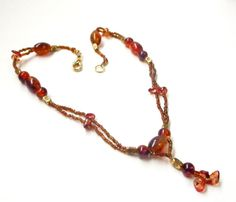 $37.00  Synthetic Amber Necklace Glass Amber Color Beaded by BijiJewelry https://www.etsy.com/listing/222117976/synthetic-amber-necklace-glass-amber?ref=shop_home_active_6