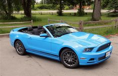 Bright blue 2013 Ford #Mustang convertible.