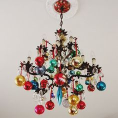 ornament chandelier. There's no such thing as too many decorations for an ugly Christmas sweater party! And if you need some sweaters for lame guests who show up without one, visit www.myuglychristmassweater.com