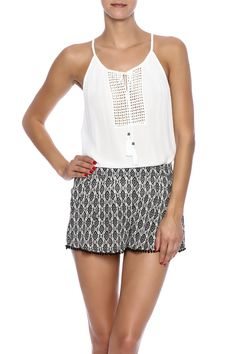 Spend the day out in the warm sun in this gauzy flowy top. This top features a delicate crochet inset on the bodice with tasseled ties. It's the perfect top for ultimate relaxation and warm-weather days. Unlined.  Chase The Sun Tank by Twist. Clothing - Tops - Sleeveless Clothing - Tops - Blouses & Shirts Santa Monica Los Angeles California