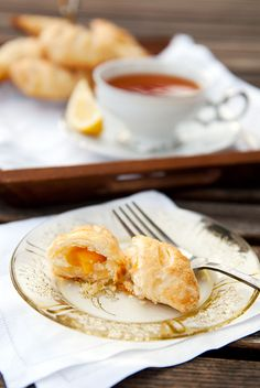 Homemade Bourbon Peach Hand Pies! Sweet peach filling wrapped in a flaky, buttery pastry! Great with coffee, tea or with a scoop of ice cream of course!