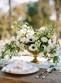 Sophisticated Wedding Flower Inspiration via oncewed.com #wedding #reception #flowers #centerpiece #elegant #classic #white #green #anemone #hellebore #ranunculus