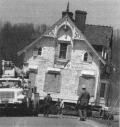 A photographer from the Indianapolis Star snapped this photo as workers relocated the city's historic Nicholson Mansion. Legend has it the man thought he saw a girl in a blue dress standing in an upstairs window. Is that her in the photo?