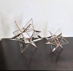 Stained glass beveled Moravian Stars. Great for coffee table art, sitting on your mantle, or adorning your vanity. Made with clear beveled glass in the Tiffany style of stained glass construction. 3 finishes: brown/black, copper or silver. 2 sizes: small-- 5.5 x 5.5 x 5.5 and large--8 x 8
