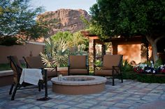Back patio seating with view of mountains and fire pit