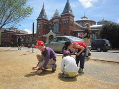 Looking for crystals in front of the Smithsonian Castle