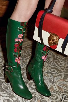 It's all in the details with decorated knee-high boots by Gucci.