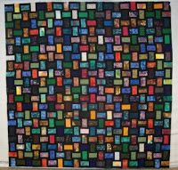 """Nickel Bricks from Loose Change book. sub block is a 4 patch made up of a 3x5 rectangle bordered by 1.5"""" black strips on 2 sides, arranged in a windmill layout.  Fabric focus, scrappy, woven look"""