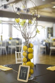 good idea for something simple.fruits and flowers can be changed to reflect colors- gray and yellow wedding decor, lemon centerpieces, a good affair wedding design Lemon Centerpieces, Wedding Centerpieces, Wedding Decorations, Table Decorations, Fruit Centerpiece Ideas, Centerpiece Flowers, Italian Centerpieces, Yellow Decorations, Kitchen Centerpiece