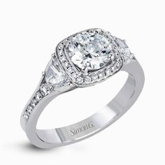 Featuring a lovely contemporary design, this white gold ring is complemented by a halo of .28 ctw round cut white diamonds and accented with .44 ctw moon shaped diamonds.