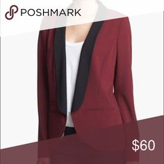 NEVER WORN Trouve Tuxedo Jacket in Burgundy A perennial favorite, the tuxedo jacket is always a great choice for work or a night out.  Looks great dressed up or down, with jeans or trousers.  Pair it with a t-shirt or tank and you're ready to go and pulled together.  A deep burgundy/wine with slit pockets at waist and black lapels.  Size L, dry clean only. Trouve Jackets & Coats Blazers