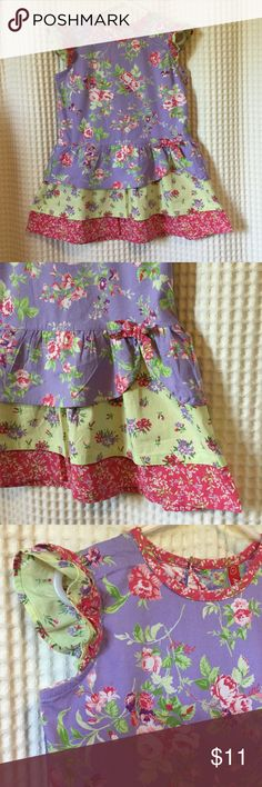 Pretty floral toddler dress 3t/4t Beautiful layers of pink green and purple. Bow detail at waistline and adorable ruffled sleeves. Approximately 3t but measures as follows.     Neckline to hem 20 1/2 inches armpit to armpit laying flat 13 inches and waistline just above ruffled skirt is 13 1/2 inches. Good preloved condition 🙂 Hanna Andersson Dresses