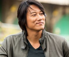 SparkLife » Hot Boys and Cool Cars: On-Set Pics From Fast and Furious 6!  This is Sung Kang. He plays Han Lue, a former gang member and street racer who looks devastatingly adorable in a leather jacket. Staring at his rakish smile and perfectly swoop-y hair for too long may cause blindness, fainting spells, and incurable crushes. WHY YOU GOTTA BE SO HANDSOME, HAN?!