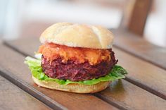 Beetroot burger with a delicious smoky flavour made with raw beetroot, chickpeas and quinoa flakes topped with a roasted butternut and tomato sauce Beetroot Burgers, Beet Burger, Burger Perfect, Roasted Butternut, Savoury Cake, Tomato Sauce, Beets, Hamburger, Vegetarian Recipes